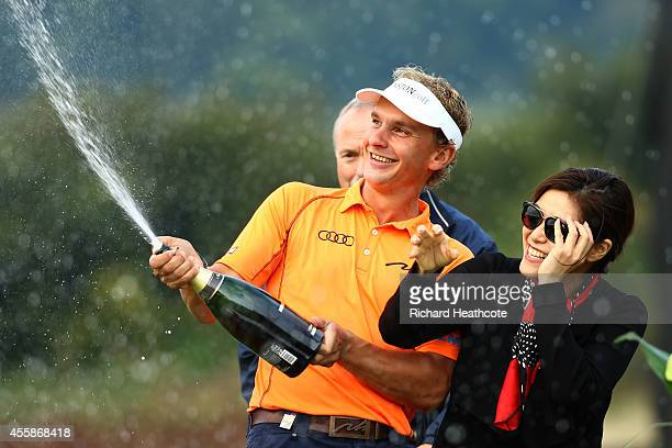 Joost Luiten of the Netherlands sprays champage following his victory on day four of the ISPS Handa Wales Open at Celtic Manor Resort on September 21...