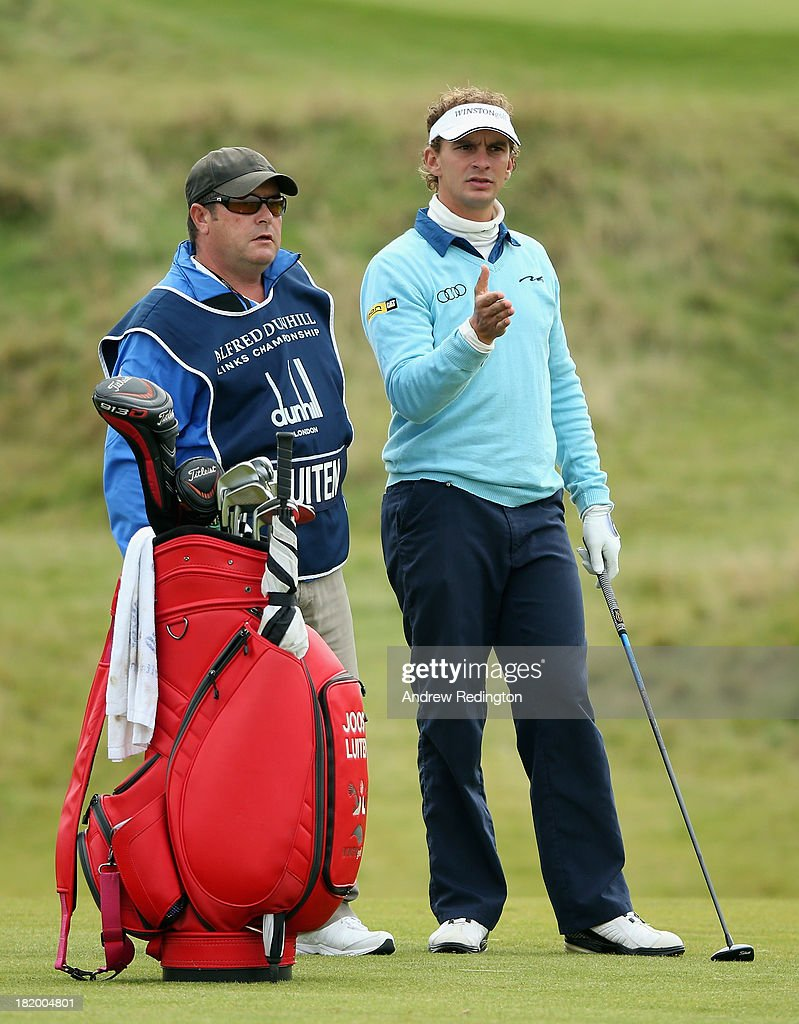 Joost Luiten of The Netherlands waits with his caddie Martin Gray on the 16th hole during the second round of the Alfred Dunhill Links Championship at Kingsbarns Golf Links on September 27, 2013 in Kingsbarns, Scotland.