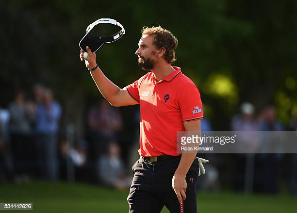 Joost Luiten of the Netherlands waves on the 18th green during day one of the BMW PGA Championship at Wentworth on May 26 2016 in Virginia Water...