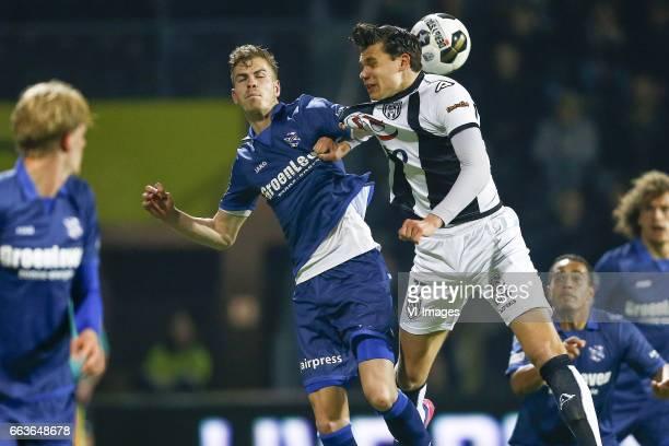 Joost van Aken of Heerenveen Justin Hoogma of Heracles Almeloduring the Dutch Eredivisie match between Heracles Almelo and sc Heerenveen at Polman...