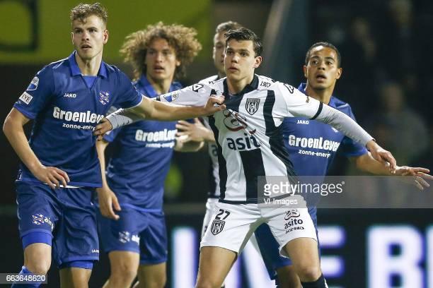 Joost van Aken of Heerenveen Wout Faes of Heerenveen Justin Hoogma of Heracles Almelo Lucas Bijker of Heerenveenduring the Dutch Eredivisie match...