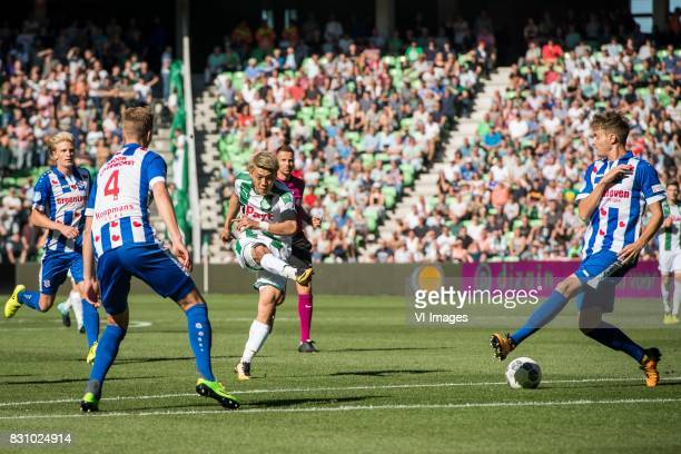 Joost van Aken of sc Heerenveen Ritsu Doan of FC Groningen Daniel Hoegh of sc Heerenveen during the Dutch Eredivisie match between FC Groningen and...