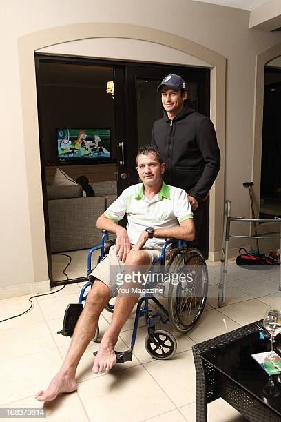 Joost van der Westhuizen in his wheelchair with his close friend Quinton van der Walt at his new home on April 22 2013 in Dainfern Johannesburg South...