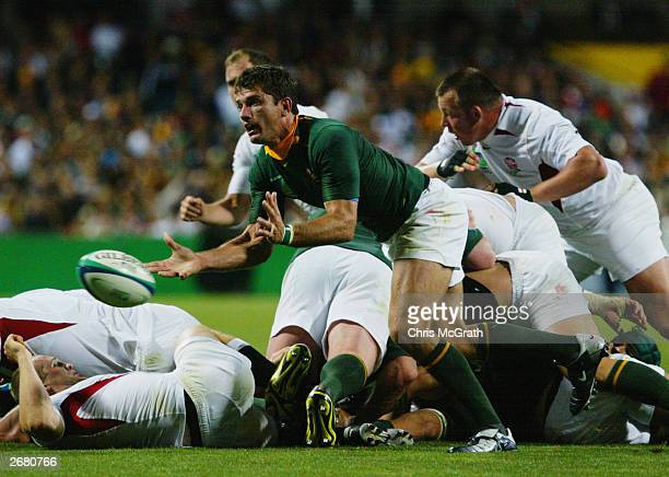 Joost van der Westhuizen of South Africa offloads the ball during the Rugby World Cup Pool C match between South Africa and England on October 18...