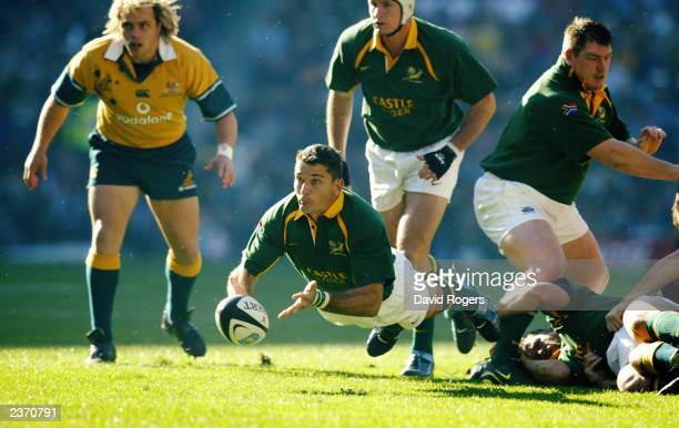 Joost Van Der Westhuizen of South Africa passes the ball during the TriNations match between South Africa and Australia held on July 12 2003 at the...