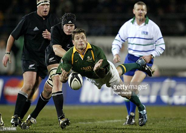 Joost van der Westhuizen of the Springboks throws out a long pass during the TriNations test match between the New Zealand All Blacks and South...