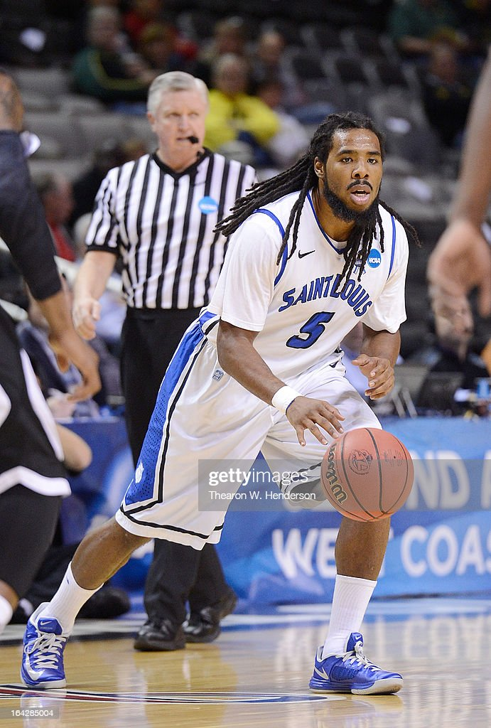 Jordair Jett #5 of the Saint Louis Billikens dribbles the ball up court against the New Mexico State Aggies in the first half during the second round of the 2013 NCAA Men's Basketball Tournament at HP Pavilion on March 21, 2013 in San Jose, California.