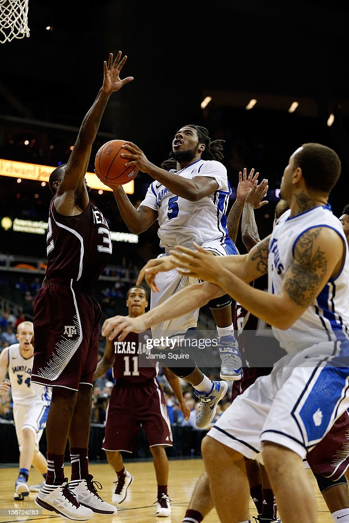Jordair Jett #5 of the Saint Louis Billikens drives to the basket as Kourtney Roberson #32 of the Texas A&M Aggies defends during the CBE Hall of Fame Classic at Sprint Center on November 19, 2012 in Kansas City, Missouri.