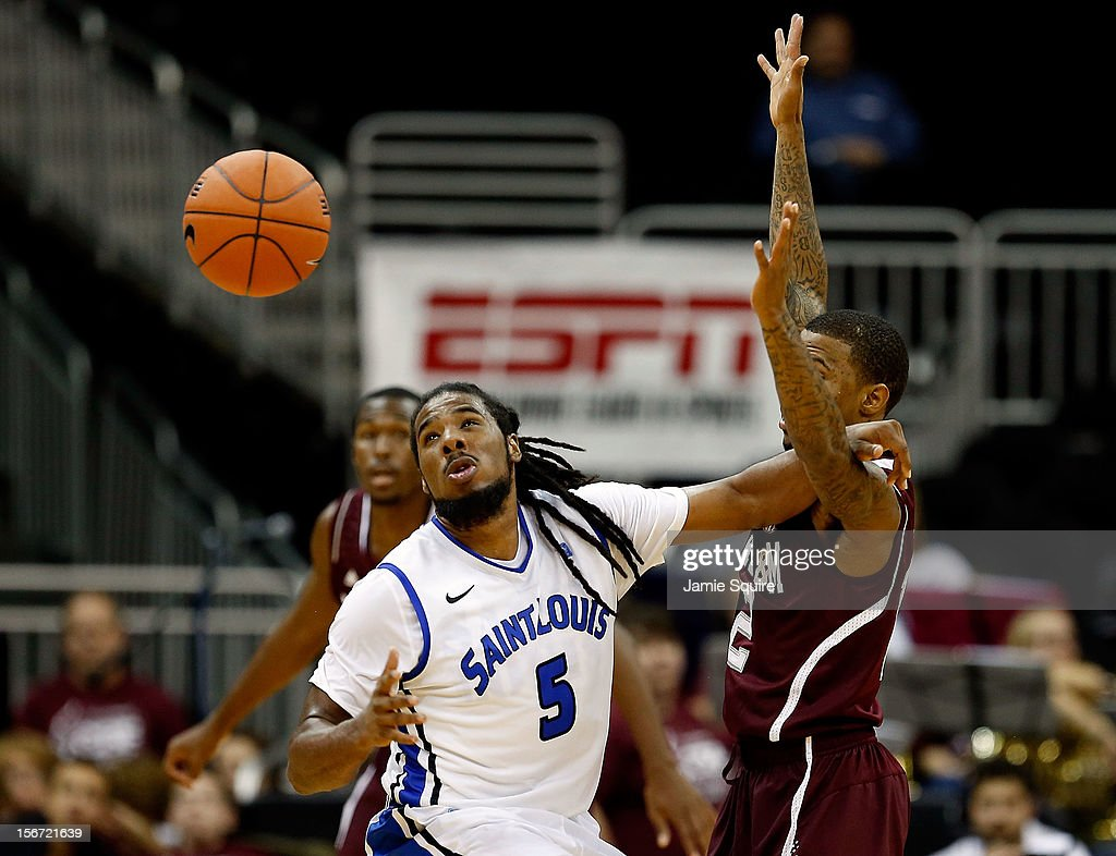 Jordair Jett #5 of the Saint Louis Billikens loses the ball as Fabyon Harris #12 of the Texas A&M Aggies defends during the CBE Hall of Fame Classic at Sprint Center on November 19, 2012 in Kansas City, Missouri.