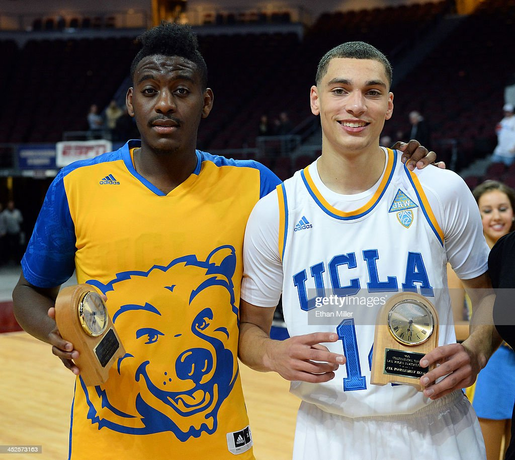 Jordan Adams #3 and Zach LaVine #12 of the UCLA Bruins hold all-tournament team awards after the Bruins defeated the Northwestern Wildcats 95-79 during the Continental Tire Las Vegas Invitational at the Orleans Arena on November 29, 2013 in Las Vegas, Nevada.
