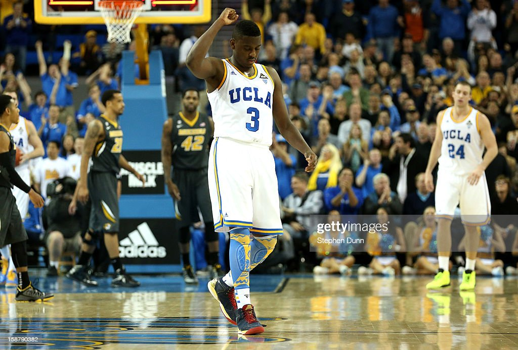 Jordan Adams #3 of the UCLA Bruins celebrates at the end of regulation after UCLA cam back to force overtime against the Missouri Tigers at Pauley Pavilion on December 28, 2012 in Los Angeles, California. UCLA won 97-94 in overtime.