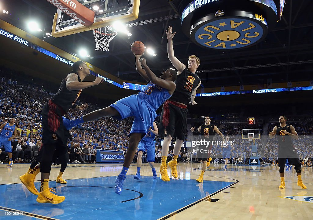 Jordan Adams #3 of the UCLA Bruins drives to the basket past James Blasczyk #31 of the USC Trojans in the second half at Pauley Pavilion on January 30, 2013 in Los Angeles, California. USC defeated UCLA 75-71 in overtime.