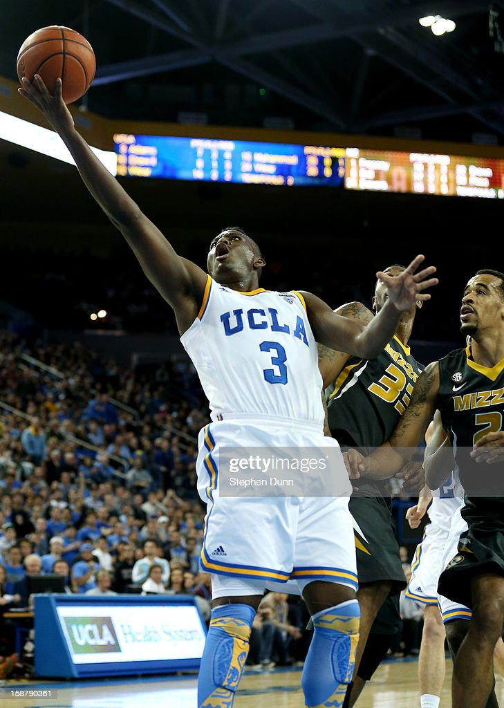 Jordan Adams #3 of the UCLA Bruins makes a shot to tie the score and send the game into overtime against the Missouri Tigers at Pauley Pavilion on December 28, 2012 in Los Angeles, California. UCLA won 97-94 in overtime.