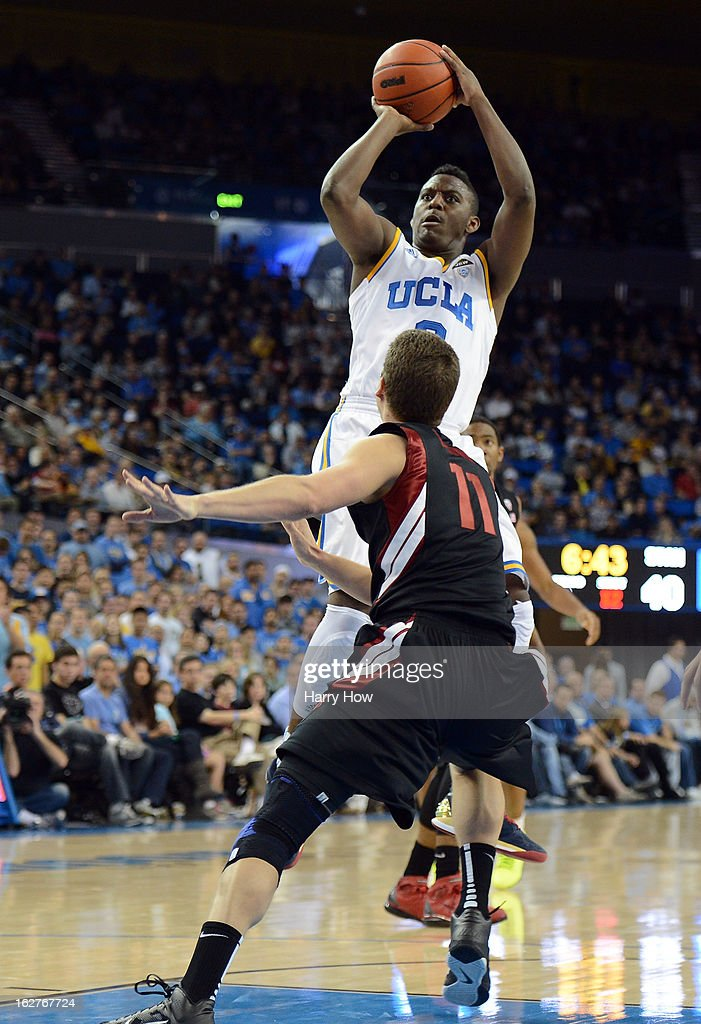 Jordan Adams #3 of the UCLA Bruins shoots over Andy Brown #11 of the Stanford Cardinal at Pauley Pavilion on January 5, 2013 in Los Angeles, California.