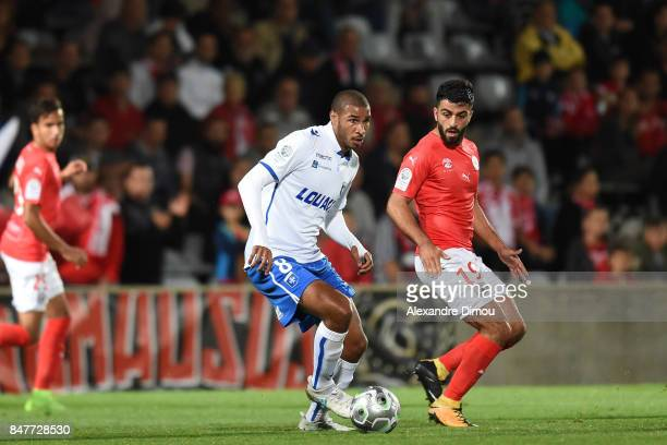 Jordan Adeoti of Auxerre and Umut Bozok of Nimes during the Ligue 2 match between Nimes and Aj auxerre on September 15 2017 in Nimes France