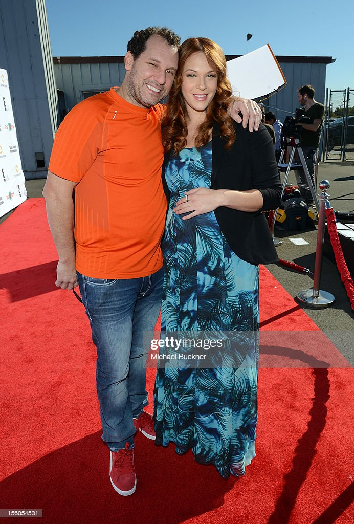 Jordan Alan (L) and actress Amanda Righetti attend the creative arts fair and family day 'Express Yourself', supporting P.S. ARTS, at Barker Hangar on November 11, 2012 in Santa Monica, California.