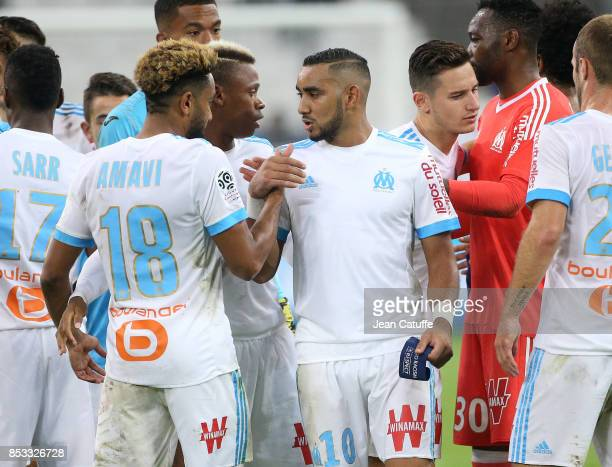 Jordan Amavi Dimitri Payet Clinton Njie Florian Thauvin of OM celebrate the victory following the French Ligue 1 match between Olympique de Marseille...