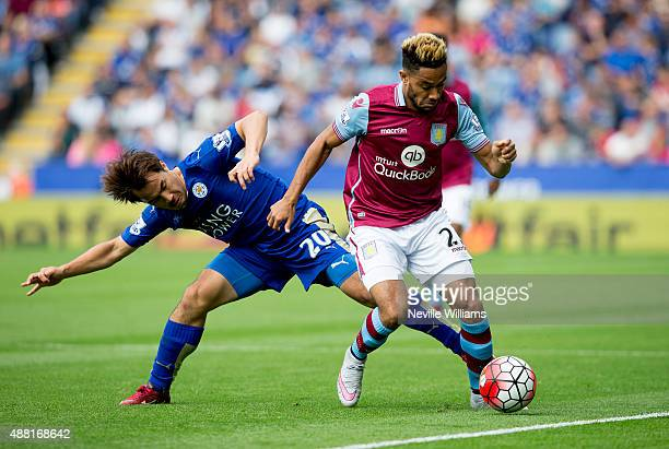 Jordan Amavi of Aston Villa is challenged by Shinji Okazaki of Leicester City during the Barclays Premier League match between Leicester City and...
