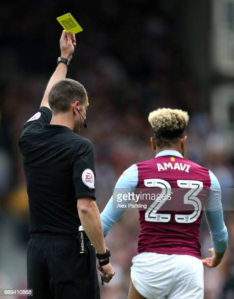 Jordan Amavi of Aston Villa is shown a yellow card during the Sky Bet Championship match between Fulham and Aston Villa at Craven Cottage on April 17...