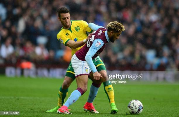 Jordan Amavi of Aston Villa is tackled by Ivo Pinto of Norwich City during the Sky Bet Championship match between Aston Villa and Norwich City at...