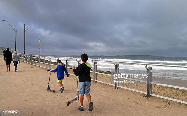 Jordan and Jesse Stone attempt to scooter along the Cronulla Esplanade on April 22 2015 in Sydney Australia Three people have died and more than...