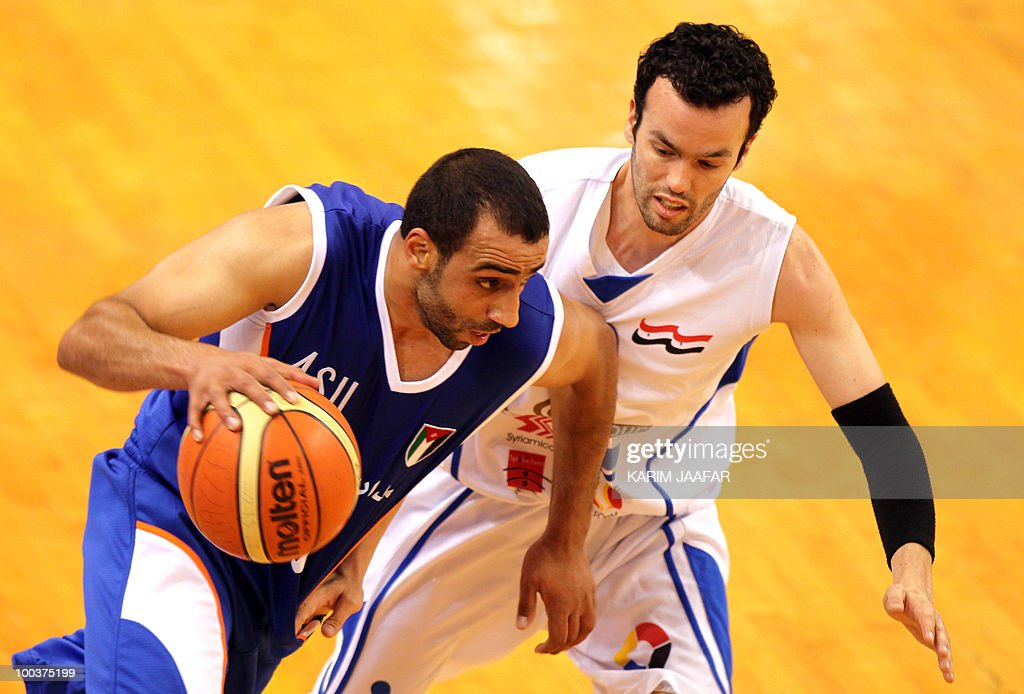 Jordan ASU club player Nedal Al-Sharif (L) vies with Syrian Al-Jalaa player Rami Merjaneh (R) from during their 21st FIBA Asia Champions Cup basketball match at the Al-Gharafa indoors stadium in Doha on May 24, 2010.