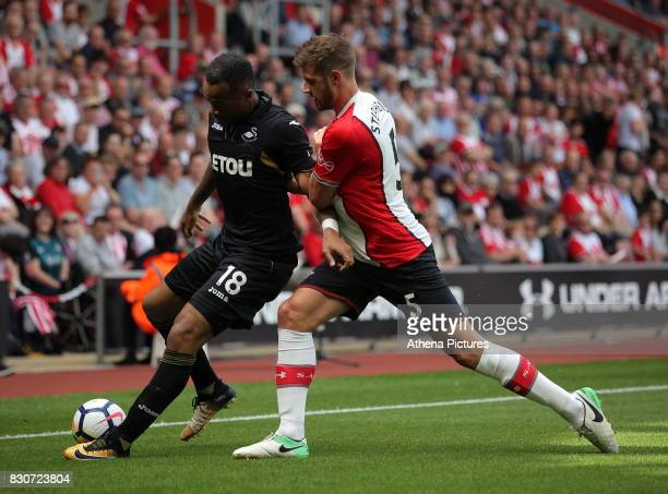 Jordan Ayew competes with Jack Stephens of Southampton during the Premier League match between Southampton and Swansea City at the St Mary's Stadium...