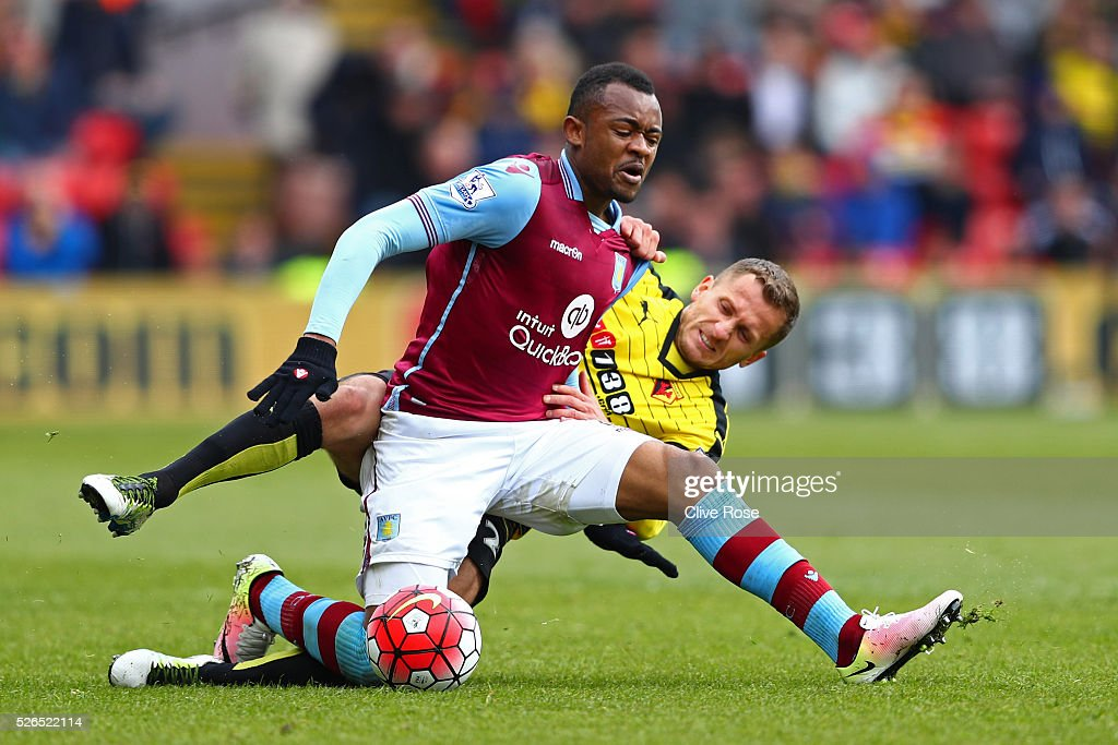 Jordan Ayew of Aston Villa and Almen Abdi of Watford compete for the ball during the Barclays Premier League match between Watford and Aston Villa at Vicarage Road on April 30, 2016 in Watford, England.