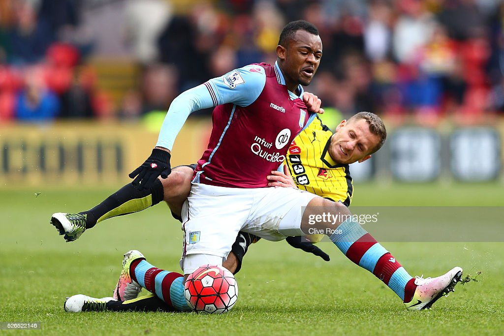 Jordan Ayew of Aston Villa and Almen Abdi of Watford compete for the ball during the Barclays Premier League match between Watford and Aston Villa at...