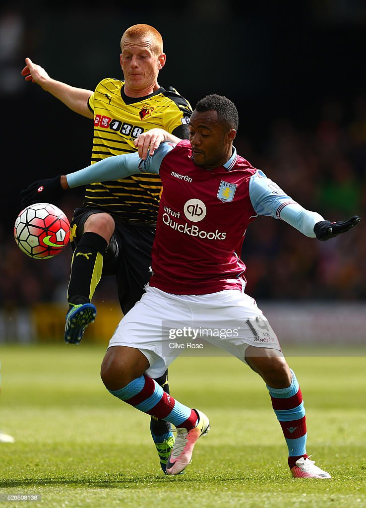 Jordan Ayew of Aston Villa and Ben Watson of Watford compete for the ball during the Barclays Premier League match between Watford and Aston Villa at Vicarage Road on April 30, 2016 in Watford, England.