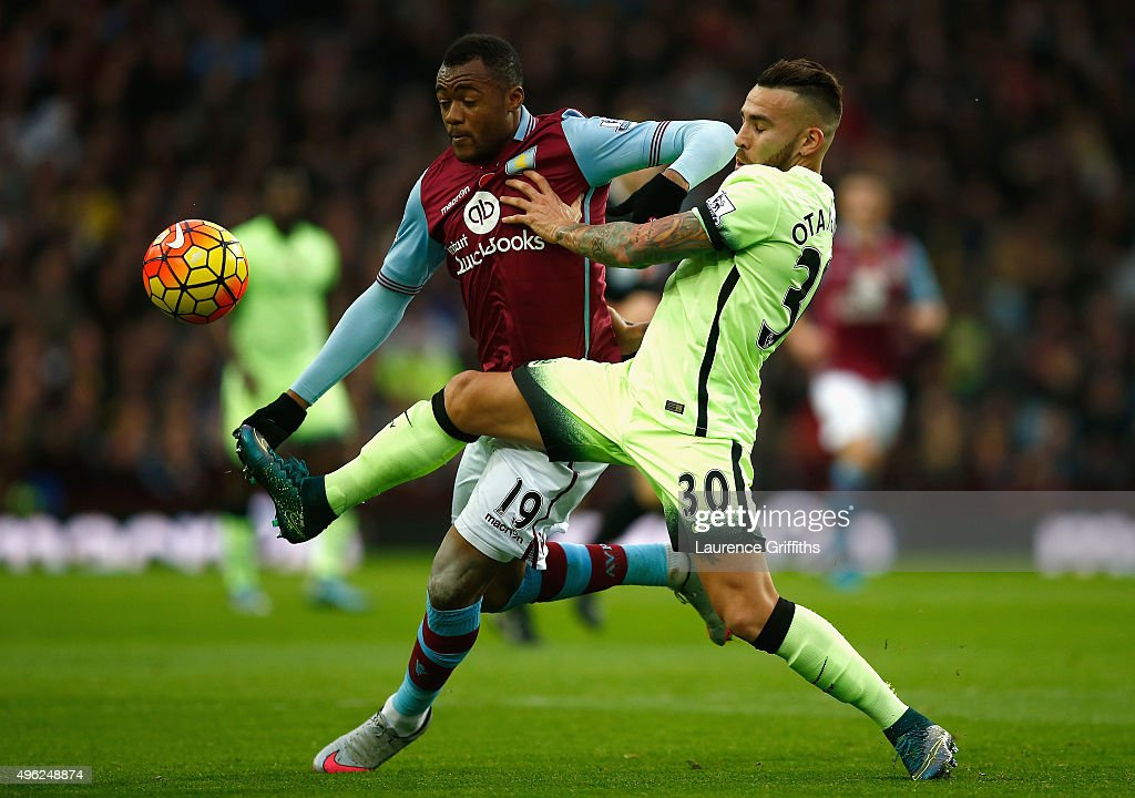 Jordan Ayew of Aston Villa and Nicolas Otamendi of Manchester City battle for the ball during the Barclays Premier League match between Aston Villa...