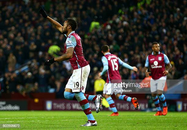 Jordan Ayew of Aston Villa celebrates after scoring his side's first goal from the penalty spot during the Barclays Premier League match between...