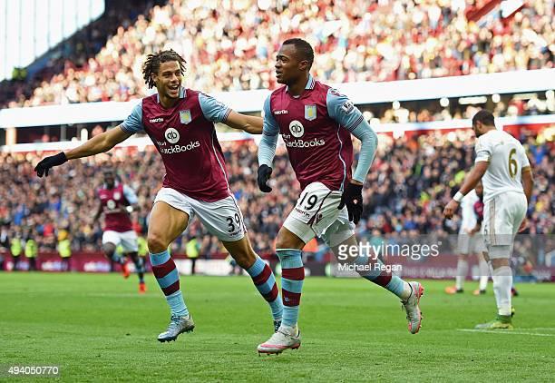 Jordan Ayew of Aston Villa celebrates scoring his team's first goal with Rudy Gestede during the Barclays Premier League match between Aston Villa...