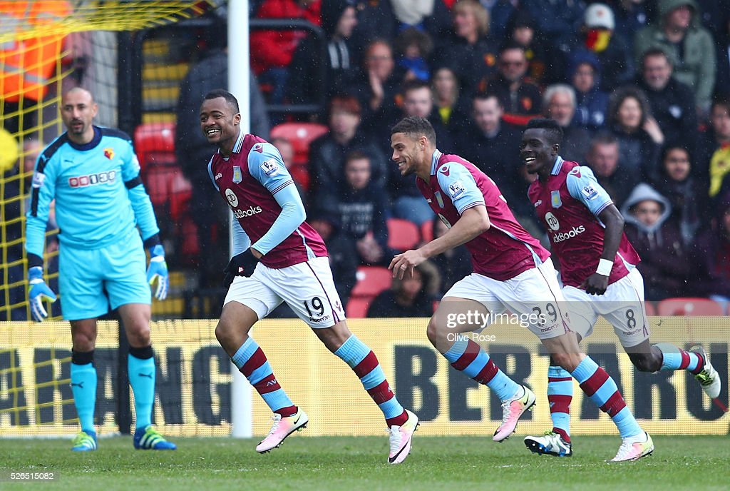 Jordan Ayew of Aston Villa celebrates scoring his team's second goal with his team mates during the Barclays Premier League match between Watford and...