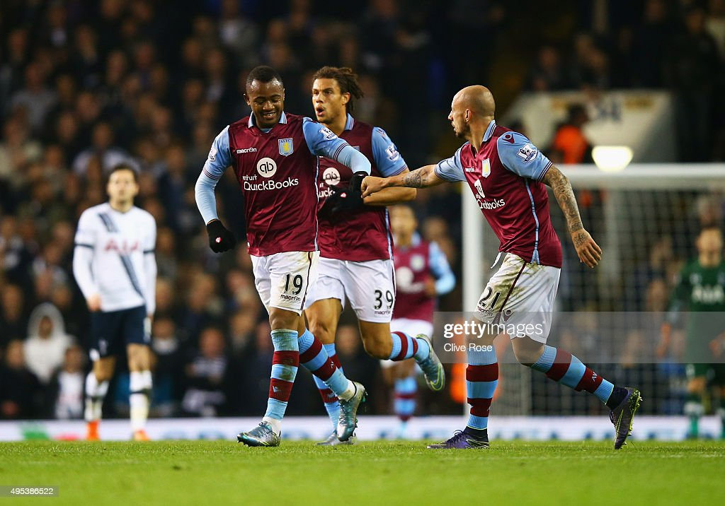 Jordan Ayew of Aston Villa (19) celebrates with Alan Hutton (21) as he scores their first goal during the Barclays Premier League match between Tottenham Hotspur and Aston Villa at White Hart Lane on November 2, 2015 in London, England.
