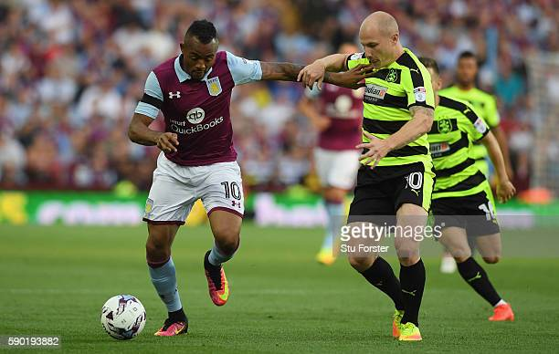 Jordan Ayew of Aston Villa holds off Aaron Mooy of Huddersfield Town during the Sky Bet Championship match between Aston Villa and Huddersfield Town...