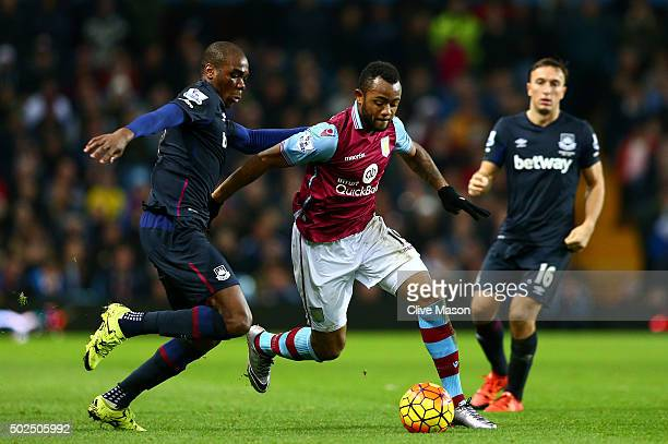 Jordan Ayew of Aston Villa holds off Angelo Ogbonna Obinza of West Ham United during the Barclays Premier League match between Aston Villa and West...