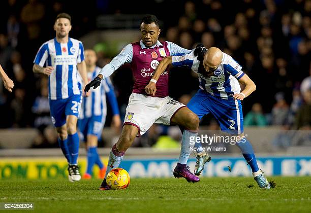 Jordan Ayew of Aston Villa is challenged by Bruno Saltor of Brighton Hove Albion during the Sky Bet Championship match between Brighton Hove Albion...