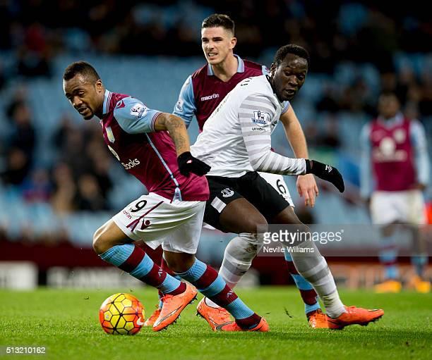 Jordan Ayew of Aston Villa is challenged by Romelu Lukaku of Everton during the Barclays Premier League match between Aston Villa and Everton at...