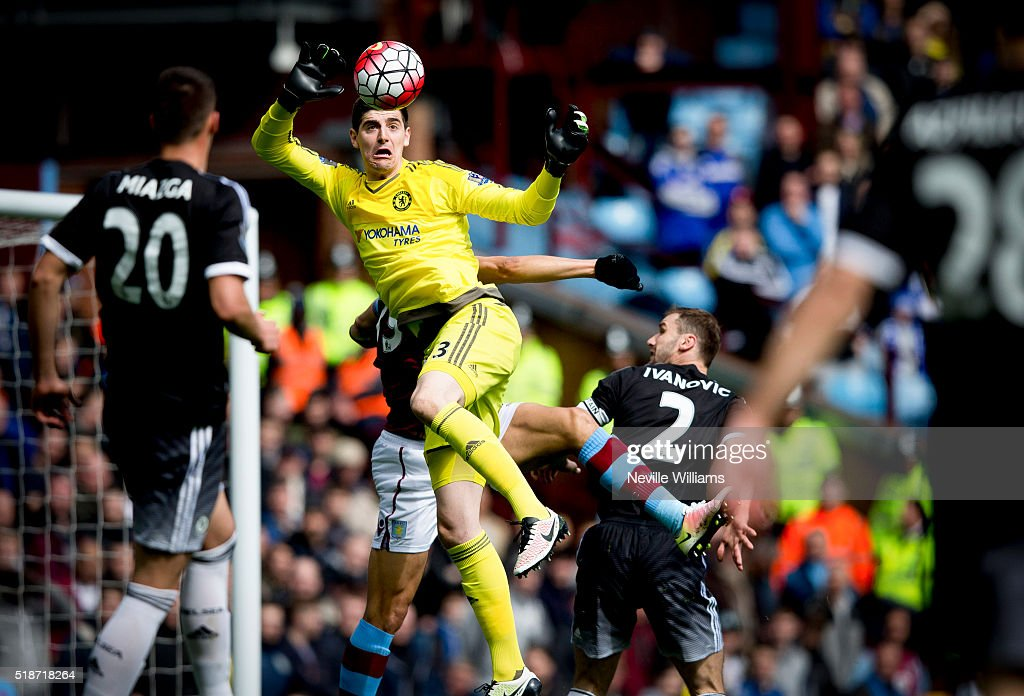 Jordan Ayew of Aston Villa is challenged by Thibaut Courtois of Chelsea during the Barclays Premier League match between Aston Villa and Chelsea at Villa Park on April 02, 2016 in Birmingham, England.