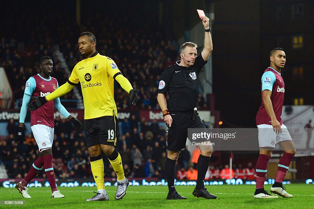 <a gi-track='captionPersonalityLinkClicked' href=/galleries/search?phrase=Jordan+Ayew&family=editorial&specificpeople=6595555 ng-click='$event.stopPropagation()'>Jordan Ayew</a> of Aston Villa is shown a red card by referee <a gi-track='captionPersonalityLinkClicked' href=/galleries/search?phrase=Jonathan+Moss+-+Soccer+Referee&family=editorial&specificpeople=14630509 ng-click='$event.stopPropagation()'>Jonathan Moss</a> during the Barclays Premier League match between West Ham United and Aston Villa at the Boleyn Ground on February 2, 2016 in London, England.