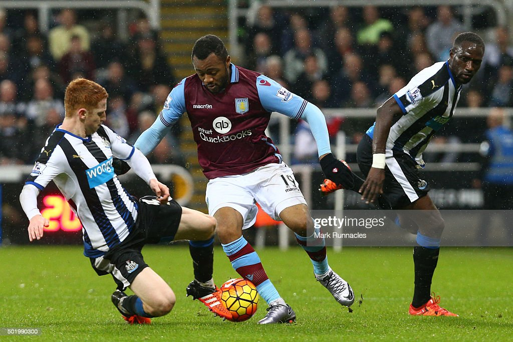 Jordan Ayew of Aston Villa is tackled by Jack Colback of Newcastle United during the Barclays Premier League match between Newcastle United and Aston...
