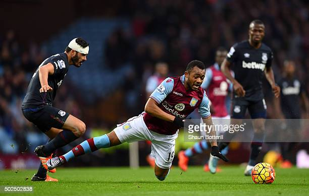Jordan Ayew of Aston Villa is tackled by James Tomkins of West Ham United during the Barclays Premier League match between Aston Villa and West Ham...
