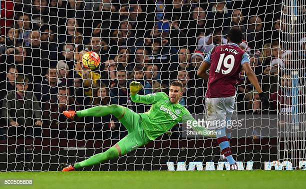 Jordan Ayew of Aston Villa scores his side's first goal from the penatly spot past Adrian of West Ham United during the Barclays Premier League match...