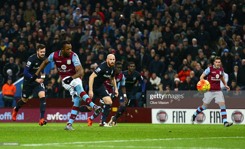 Jordan Ayew of Aston Villa scores his side's first goal from the penatly spot during the Barclays Premier League match between Aston Villa and West...
