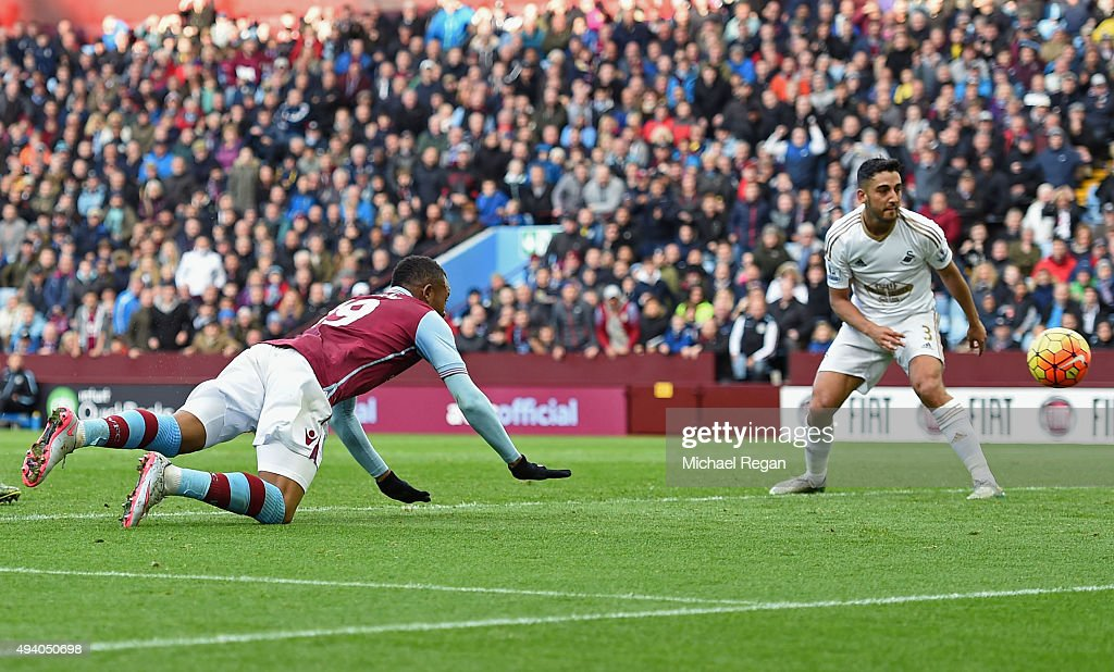Jordan Ayew of Aston Villa scores his team's first goal during the Barclays Premier League match between Aston Villa and Swansea City at Villa Park...