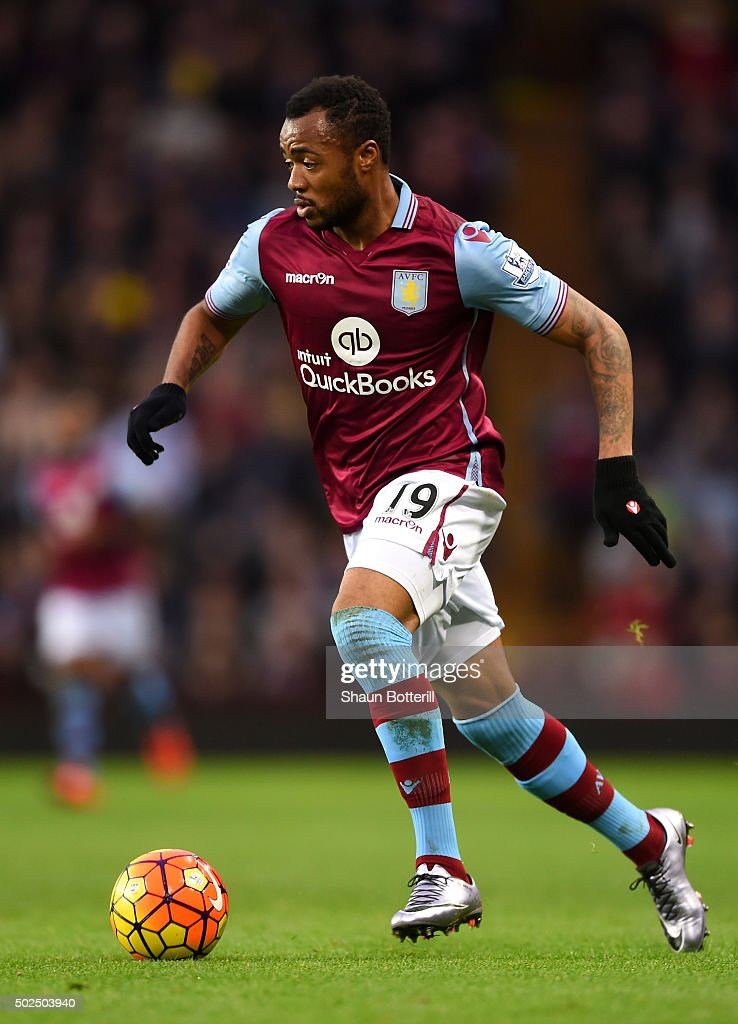 Jordan Ayew of Aston Villa takes the ball forward during the Barclays Premier League match between Aston Villa and West Ham United at Villa Park on...