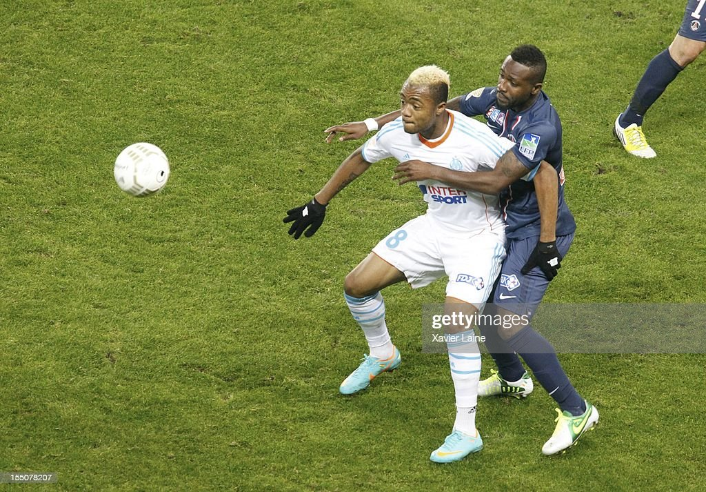 <a gi-track='captionPersonalityLinkClicked' href=/galleries/search?phrase=Jordan+Ayew&family=editorial&specificpeople=6595555 ng-click='$event.stopPropagation()'>Jordan Ayew</a> of Olympique de Marseille and <a gi-track='captionPersonalityLinkClicked' href=/galleries/search?phrase=Siaka+Tiene&family=editorial&specificpeople=788647 ng-click='$event.stopPropagation()'>Siaka Tiene</a> of Paris Saint-Germain in action during the French Ligue 1 between Paris Saint-Germain and Olympique de Marseille, at Parc des Princes on October 31, 2012 in Paris, France.