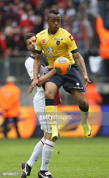 Jordan Ayew of Sochaux and Thiago Motta of PSG in action during the french Ligue 1 match between FC Sochaux Montbeliard and Paris SaintGermain FC at...