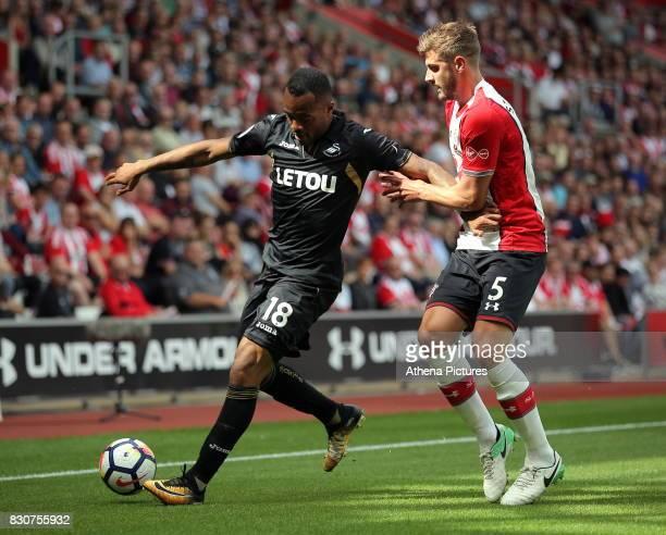 Jordan Ayew of Swansea City against Jack Stephens of Southampton during the Premier League match between Southampton and Swansea City at the St...